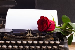 Berman Editorial: Red rose on typewriter image